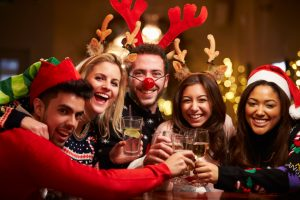 Group Of Friends Enjoying Christmas Drinks In Bar
